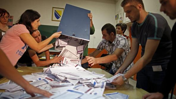 Election Commission officials count votes in the central Bosnian town of Zenica October 12, 2014. Bosnians voted for national, regional and local representatives on Sunday in elections dominated by still-unresolved issues of identity and statehood after a