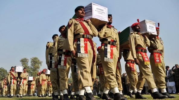 \'Pakistani soldiers carry the coffins of their comrades who were killed in a NATO strike during a funeral ceremony in Peshawar on November 27, 2011. The United States moves to salvage ties with Pakis