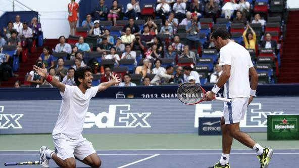 'Ivan Dodig (R) of Croatia and Marcelo Melo of Brazil celebrate after winning the men\'s doubles final against Fernando Verdasco and David Marrero of Spain at the Shanghai Masters tennis tournament Oc