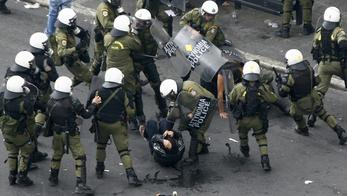 'Demonstrators are arrested by riot policemen during a protest against the visit to Greece by Germany\'s Chancellor Angela Merkel in Athens, October 9, 2012. Germany\'s Angela Merkel arrived in Greece