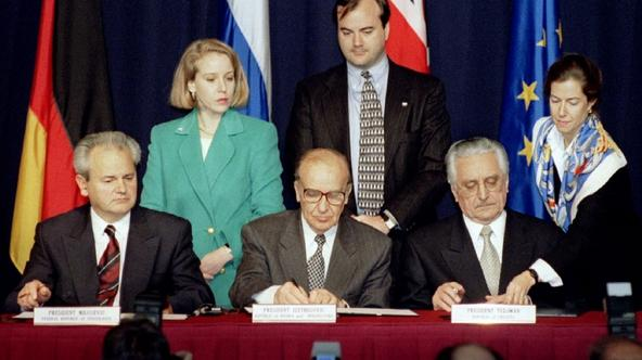 'President Slobodan Milosevic of Serbia (L), President Alija Izetbegovic of Bosnia-Herzegovina (C) and President Franjo Tudjman of Croatia sign the Dayton Agreement peace accord at the Hope Hotel insi