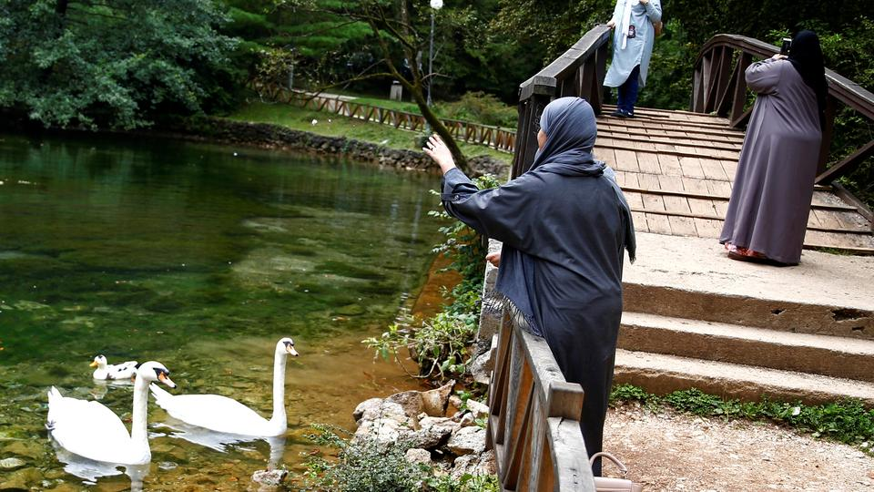 Tourists from the Middle East enjoy at Vrelo Bosne nature park in Ilidza near Sarajevo, Bosnia and Herzegovina, August 19, 2016. Picture taken August 19, 2016. REUTERS/Dado Ruvic