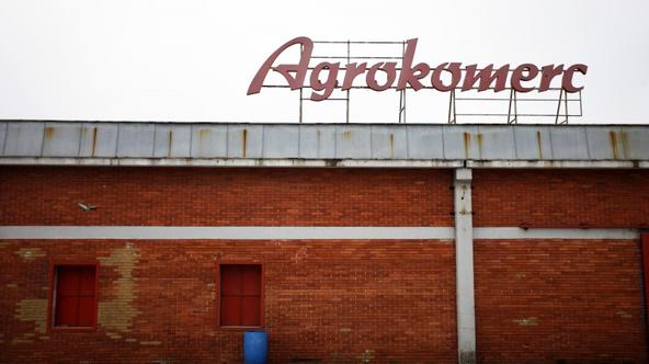 'The logo of Agrokomerc stands on top of an abandoned food processing building near Velika Kladusa, April 3, 2012. Five gutted houses and a moth-balled factory are all that remains in this northern Bo