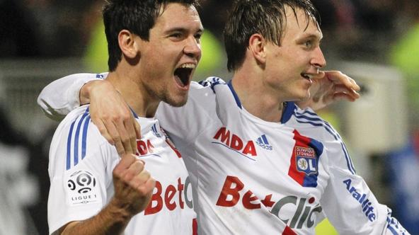 'Olympique Lyon's Kim Kallstrom (R) celebrates with team mate Dejan Lovren his team's first goal against Auxerre during their French Ligue 1 soccer match at the Gerland stadium in Lyon December 22,
