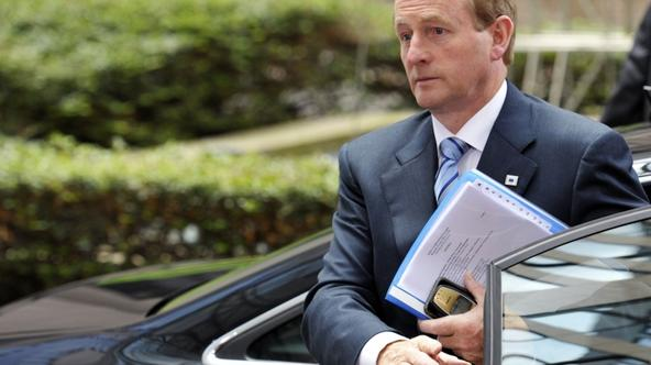 'Ireland's Prime Minister Enda Kenny arrives at the European Council building ahead of an euro zone leaders crisis summit that could lead to a new bailout plan for debt-stricken Greece, in Brussels J