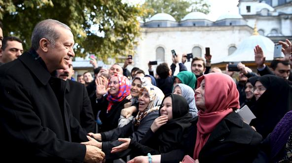 Turkish President Tayyip Erdogan (L) is greeted by his supporters during his visit to the Eyup Sultan mosque in Istanbul, Turkey, November 2, 2015 in this handout photo provided by Presidential Press Office. President Erdogan said on Monday the nation had