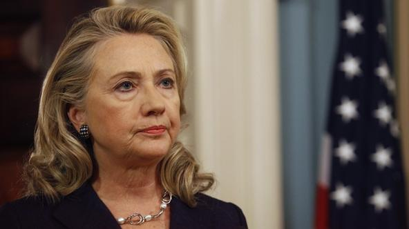 'U.S. Secretary of State Hillary Clinton delivers remarks at the State Department in Washington on the deaths of U.S. embassy staff in Benghazi in this September 12, 2012 file photo. Clinton said Dece