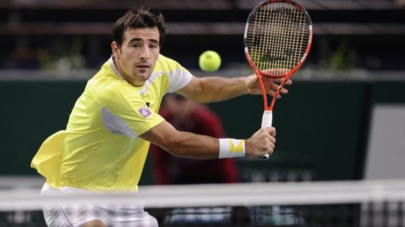 'Croatia\'s Ivan Dodig returns the ball to Serbia\'s Novak Djokovic during their Paris Tennis Masters Series indoor tournament tennis match on November 9, 2011 at the Bercy Palais-Omnisport (POPB) in