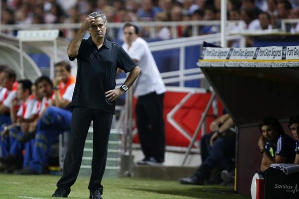'Real Madrid's coach Jose Mourinho reacts during their Spanish First Division soccer match against Sevilla at Ramon Sanchez Pizjuan stadium in Seville September 15, 2012. REUTERS/Marcelo del Pozo (SP