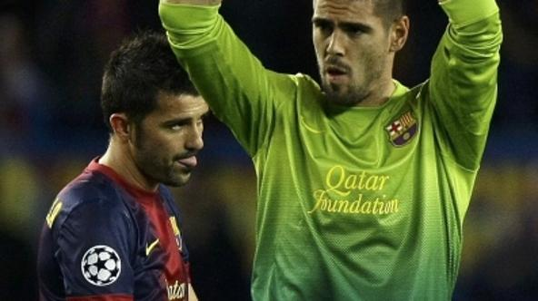 'Barcelona's goalkeeper Victor Valdes (R) and David Villa react as they leave the pitch at the end of their Champions League semi-final second leg soccer match against Bayern Munich at Camp Nou stadi