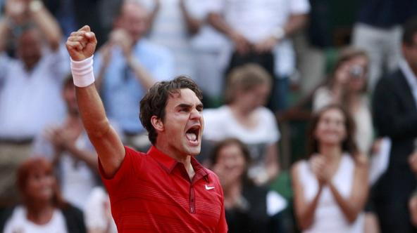 'Roger Federer of Switzerland reacts after defeating Novak Djokovic of Serbia during their semi-final match at the French Open tennis tournament at the Roland Garros stadium in Paris June 3, 2011.