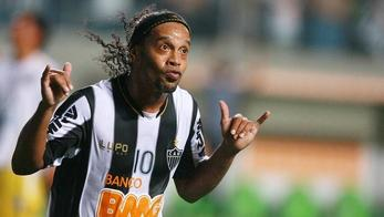 'Ronaldinho, of Brazil\'s Atletico Mineiro, celebrates after scoring against Bolivia\'s The Strongest during a Copa Libertadores match at Independencia Arena, in Belo Horizonte, southeastern Brazil, o