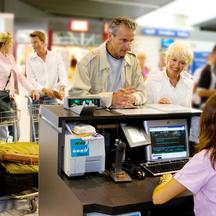 Senior couple at check in counter at airport, Image: 6097335, License: Rights-managed, Restrictions: , Model Release: yes, Credit line: Profimedia, Alexandre Jacques